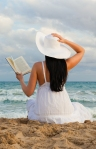 woman-reading-book-on-beach